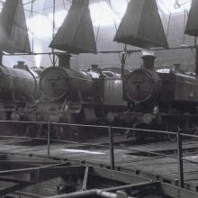 Inside the dark dirty depths of Bristol St. Phillips Marsh depot G.W. 2-6-0 No. prepared for duty. This photo is thought to have been taken in July 1962, later that month 9466 was transferred to Tondu 86F.